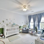 Nursery with custom-painted walls designed by Vernon Caldera, LBRB Design.